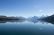 Mountains mirrored off of Lake McDonald in Glacier National Park Montana