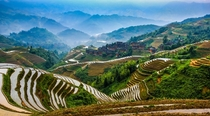 Mountaintop village in Longsheng China surrounded by rice terraces