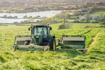 Mowing silage with a John Deere r and Krone butterfly mowers in West Cork Ireland x OC