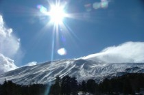 Mt Etna covered in January snow the largest active volcano in Europe its not just rising clouds you see