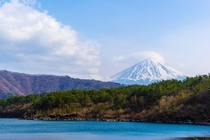 Mt Fuji in Japan towering over the surrounding mountains from Lake Saiko