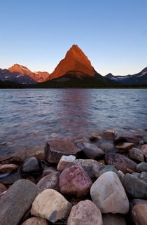 Mt Grinnell catching the first rays of sunrise Glacier National Park MT