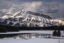 Mt Rundle amp Two Jack Lake after a night of surprise snowstorm at the end of April Banff Alberta