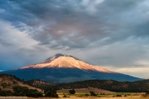Mt Shasta California illuminated with a strip of light during a break in the storm