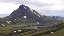 Mt Strasla Iceland covered in green moss and black volcanic ash