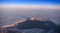 Mt Taranaki New Zealand casting a shadow over the clouds it was holding back this morning
