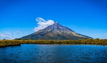 Mt Taranaki one of the most symmetrical volcanos in the world on a clear summer day New Zealand