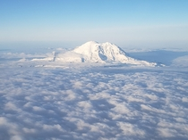 MtRainier standing high above blanket of clouds