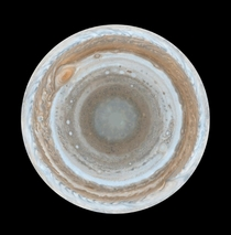 Multiple Cassini images combined to show the entirety of Jupiters illuminated south pole
