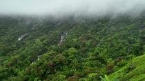 Multiple Waterfalls and clouds coming down in monsoon Mahuli fort India