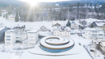 Muse Atelier Audemars Piguet is a spiral-shaped building rising up out of the landscape of Valle de Joux in Switzerland designed by BIG for the watchmaker to house its collection of timepieces