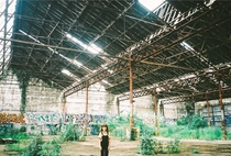 My daughter in an abandoned train shed mm film Erskineville NSW Australia
