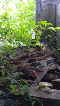 My favourite abandoned house was torn down This is all thats left Collapsed chimney and one wall
