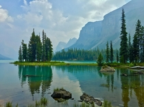 My favourite location on the planet Spirit Island in Banff National Park in Canada The haze in the photo is from the Fort McMurray wildfires