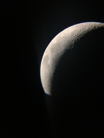 My first attempt at astrophotography- a photo of the crescent moon tonight through my celestron astromaster reflector taken one my phone
