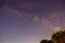 My first attempt at photographing the Milky Way with Jupiter and Saturn bottom from my backyard