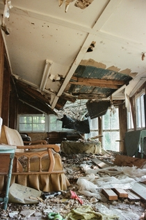 My friends family has a dilapidated lakefront property in Massachusetts The roads are too steepnarrow to get a large vehicle down to repair it This is the houses sunroom Shot on film in
