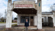 My Grandfather  standing in front of the gas station where he worked his first job