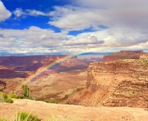 My mom caught this rainbow with her cell phone on a drive through Canyonlands NP Utah