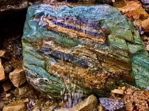 My second favorite rock in the Verdugo Mountains of Southern California  x   - Look at those colors and the little waterfall flowing over it
