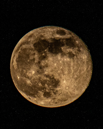 My shot of last nights moon taken from my bedroom window on a mm lens