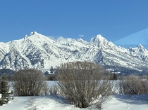 My uncle isnt on Reddit but he wouldnt mind sharing his winter Teton photo taken just yesterday oc