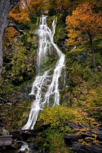 Mystical waterfall in autumn Argentina - photographed by Martin Bordagaray