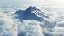 Mytikas looming above the clouds Mount Olympus highest peak Greece