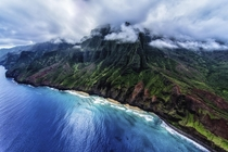 Na Pali Coast Kauai Hawaii Taken from an open door helicopter The clouds began to break as we were headed back inland Photo by Keith Manning