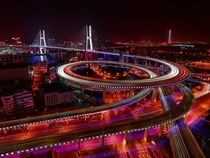 Nanpu Bridge and its km long circular junction which climbs up through  loops Shanghai