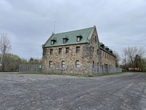 Napierville Junction Train station former train station in Lacolle QC Built in  Its one of the two chteau-style train stations in Canada All stones on this building are from the area The gate is to prevent intruders since its been abandoned since