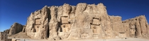 Naqsh-e Rustam is an ancient necropolis once belonging to Achaemenid kings located northwest of Persepolis in Iran The oldest relief dates to c  BC Though it is severely damaged it depicts a faint image of a man with unusual head-gear which is thought to