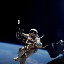 NASA Astronaut Ed White performing the first American spacewalk  He holds a HHMU or maneuvering gun which shoots oxygen to propel the astronaut  photo NASA