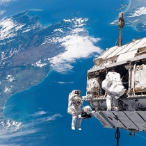 NASA astronauts working on the construction of the International Space Station over New Zealand in December