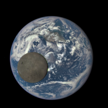 NASA camera shows dark side of the moon fully illuminated by the sun crossing the face of the Earth