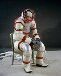 NASA designer Vic Vykukal demonstrates the AX- hard-shell spacesuit  The AX- enables movement by using ball bearings and wedges at the joints and can function at higher pressures than traditional soft-shell suits