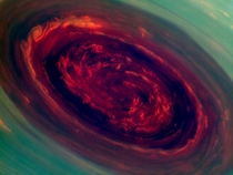 NASA probe spies giant hurricane on Saturn