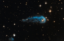 NASAs Hubble Sees a Cosmic Caterpillar - This light-year-long knot of interstellar gas and dust resembles a caterpillar on its way to a feast