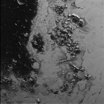 NASAs New Horizons Finds Second Mountain Range in Plutos Heart