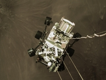 NASAs Perseverance rover being lowered to the surface by the sky crane during yesterdays landing