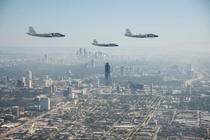 NASAs three WB-s flying over foggy downtown Houston Texas  Credit NASARobert Markowitz
