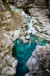 Naturally brilliant turquoise pools of the Verzasca River - Ticino Switzerland