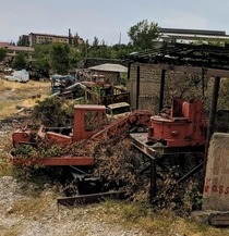 Nature is slowly reclaiming these abandoned construction vehicles shunted off the side of a new highway in Armenia