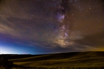 Near the WashingtonIdaho border sits the rolling fields of the Palouse The minor light pollution out here obscured the Milky Way with a little haze but was still very fun to shoot