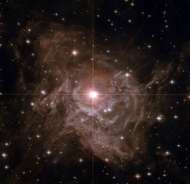 Nearby Cepheid Variable RS Pup -- It is one of the most important stars in the sky It is surrounded by a dazzling reflection nebula The brightest star in the image center is some ten times more massive than our Sun and on average  times more luminous