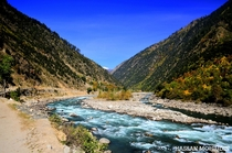Neelum River flowing through the Neelum Valley in Azad Kashmir Pakistan  by Hassan Mohiudin