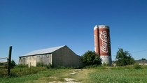 Neglected Coca-Cola silo and shack off the side of a Kansas highway