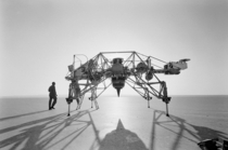 Neil Armstrong next to a Lunar Landing Research Vehicle LLRV nicknamed the flying bedstead at Edwards Air Force Base California August