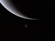 Neptune and one of its moons Triton Taken by the Voyager  spacecraft