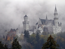Neuschwanstein castle through mist Germany